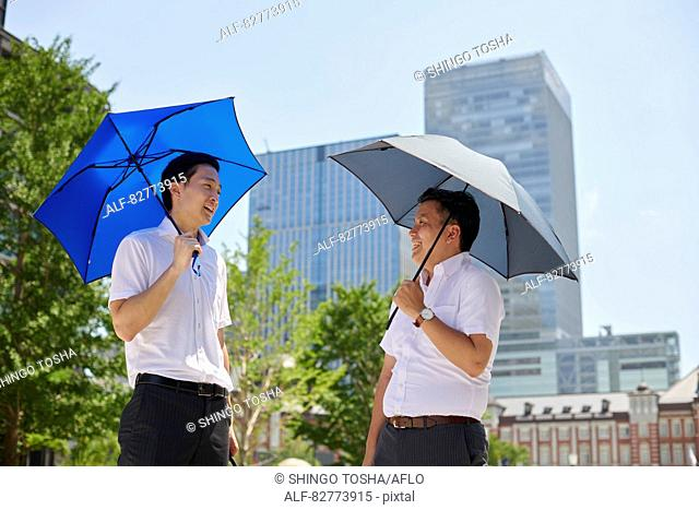 Japanese men with parasol