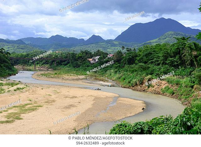 Nam Khan river with a bridge in Luang Prabang, Laos