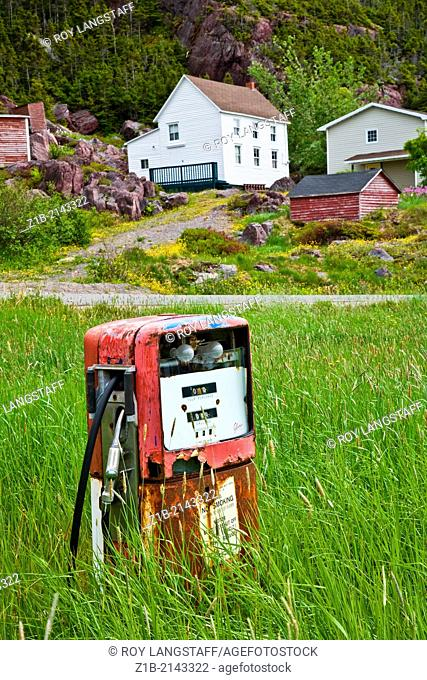 An old gas station overrun with grass and weeds in Newfoundland, Canada