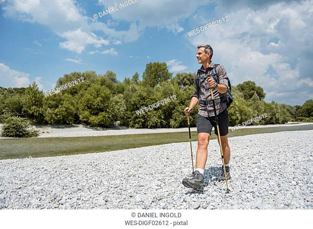 Hiker walking at the riverbank