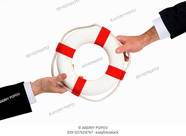 Cropped image of businessmen passing lifebuoy over wooden table