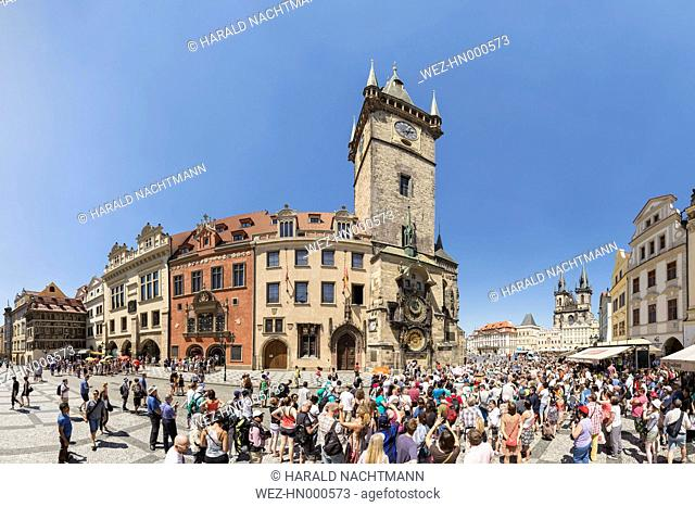 Czech Republic, Prague, Crowds of tourists in front of the Astronomical clock at Old Town Hall with Tyn Cathedral in the background
