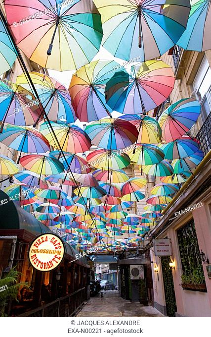 Umbrellas hanging in passage, Bucharest, Romania, Europe