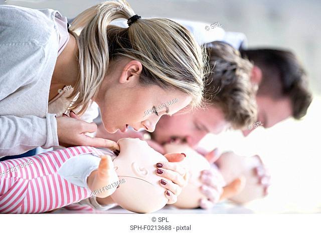Doctors practising infant CPR