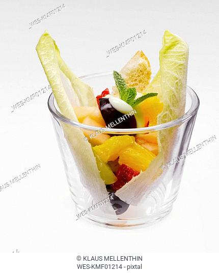 Fruit salad with lime mayonnaise in glass