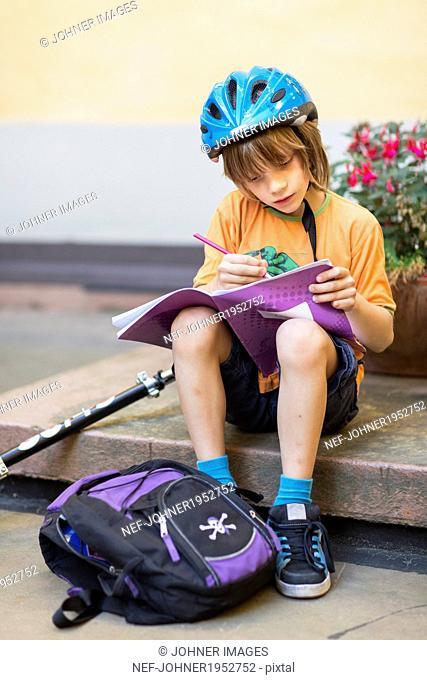 Boy doing homework, Stockholm, Sweden