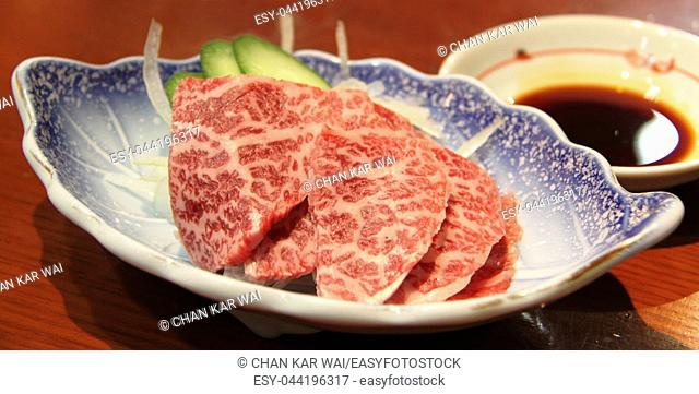 Hida beef sashimi served with dipping soya sauce