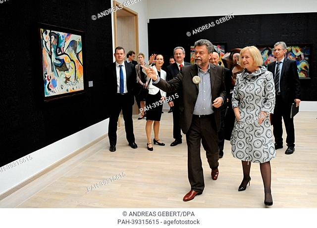 Director of the Lenbachhaus Helmut Friedel (L) leads a tour of the newly renovated Lenbachhaus with German Education Minister Johanna Wanka in Munich, Germany