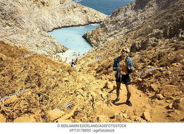 young man at Seitan Limania Beach, Crete, Greece