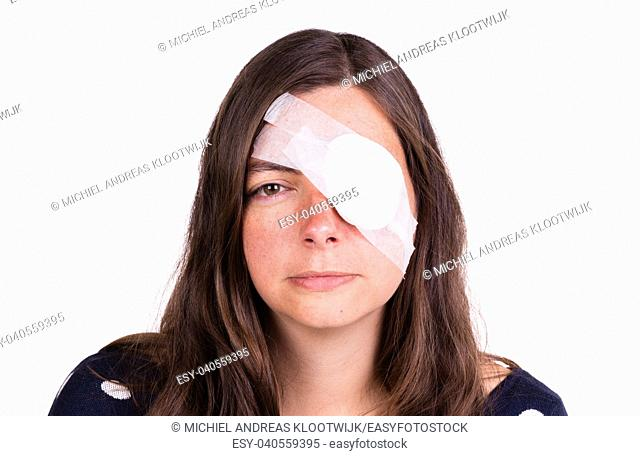 Portrait of woman wearing white eye patch as protection after injury