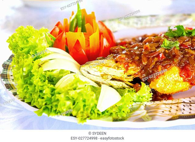 fish roasted with red chilie sauce