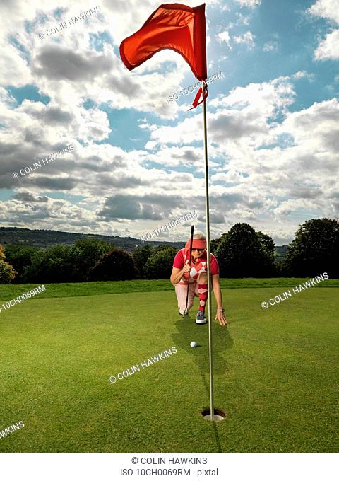 Mature lady playing golf