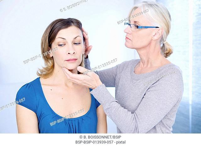 Doctor examining scalp of a patient