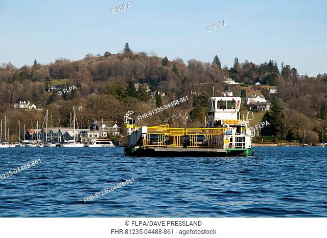 Car ferry travelling across lake, Lake Windermere, Lake District N.P., Cumbria, England, February