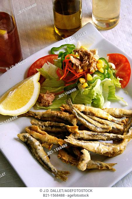 'Boquerones fritos'  fried anchovies with salad, a typical meal from Malaga, Andalusia, Spain