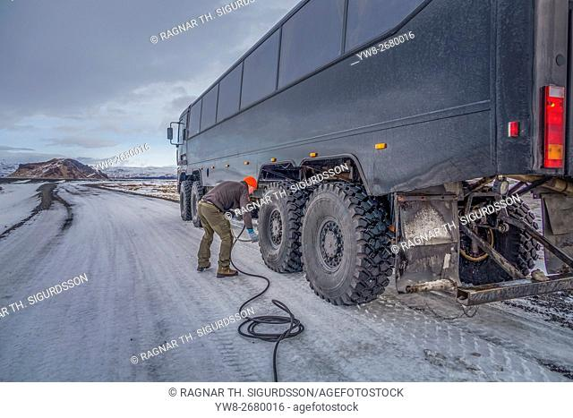 Pressure of the tires being checked to travel over rough terrain in the Thjorsardalur valley, Thorsmork, Iceland