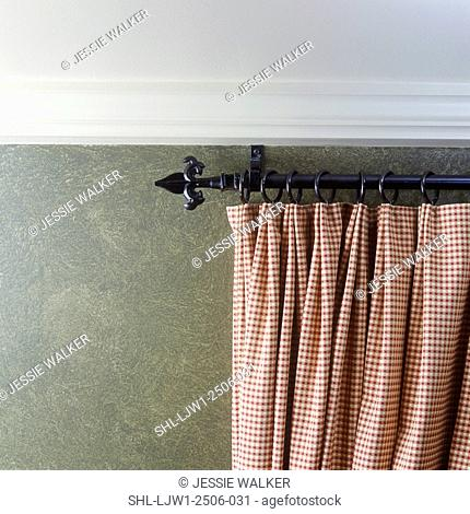 WINDOW TREATMENT: Detail of checkered drape on wrought iron rod. Faux painted wall