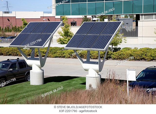 Environmentally friendly solar panels generating electricity at the Great River Energy building. Maple Grove Minnesota MN USA