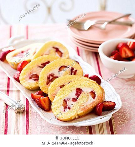 Strawberry and cream Swiss roll, sliced