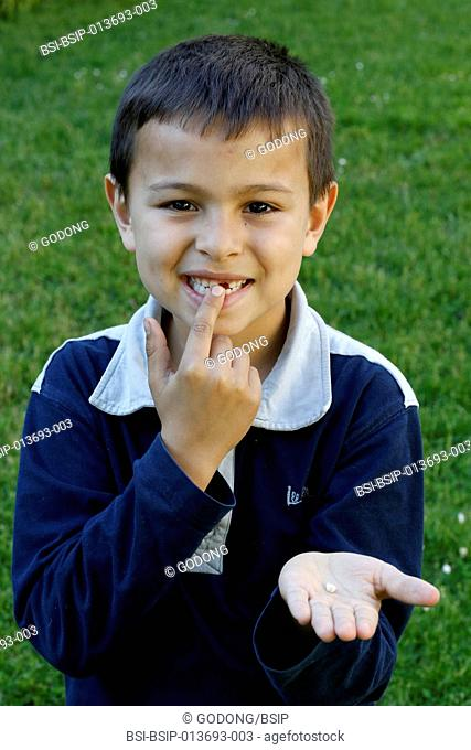7-year-old boy showing a missing tooth