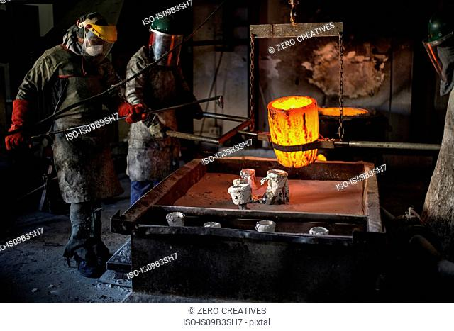 Metalworkers working in foundry