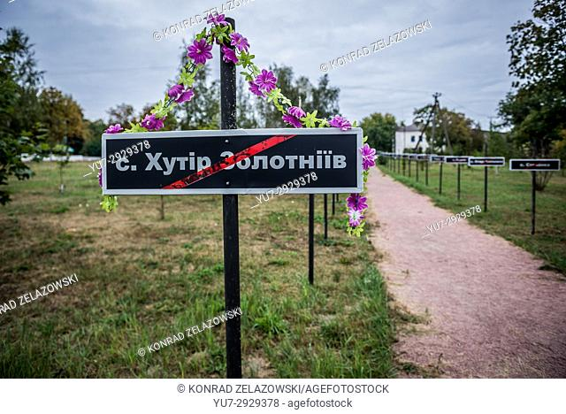 Alley with a signs of displaced villages in Chernobyl town, Chernobyl Nuclear Power Plant Zone of Alienation around nuclear reactor disaster, Ukraine