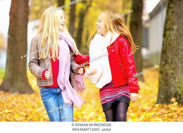 Two happy girls in autumn