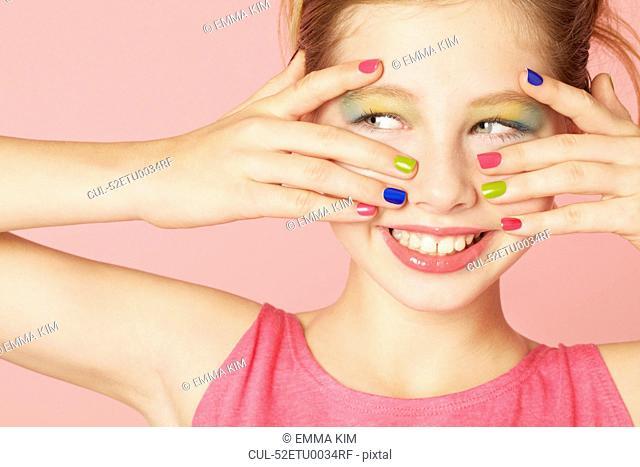 Smiling girl wearing colorful makeup