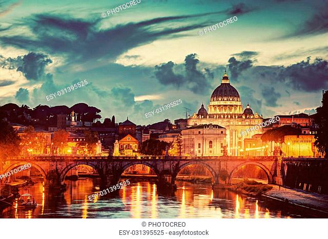 St. Peter's Basilica in Vatican City and Ponte Sant'Angelo bridge over Tiber river in Rome, Italy in the evening