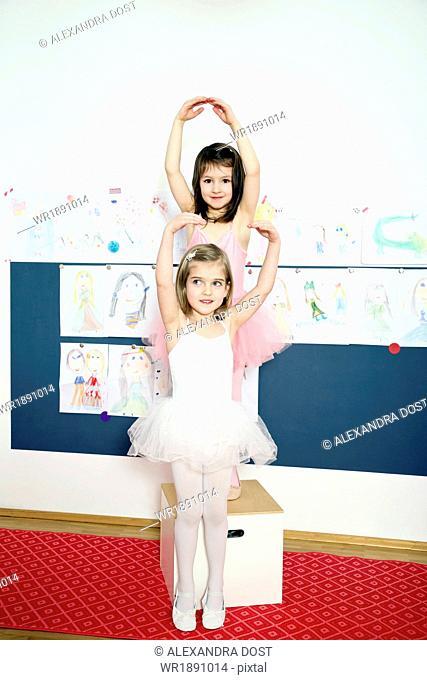 Two girls posing as little ballerinas
