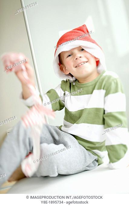 Boy (4-5) wearing Santa hat
