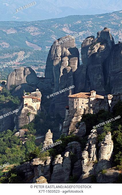 Looking down on the monasteries of Roussanou right and St  Nicholas Anapafsas Left  Meteora, Kalambaka, Thessaly, central Greece