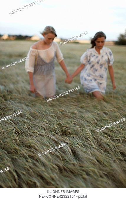 Girls walking through field
