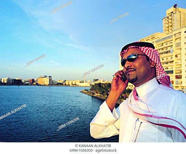 Saudi businessman using mobile phone in Jeddah, Saudi Arabia