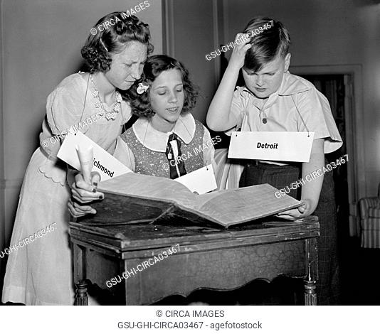 Three Children Studying Words during 16th National Spelling Bee Competition Sponsored by Louisville Courier-Journal, Washington DC, USA, Harris & Ewing
