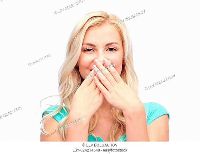 emotions, expressions, embarrassment and people concept - confused young woman or teenage girl wrinkling and closing her nose