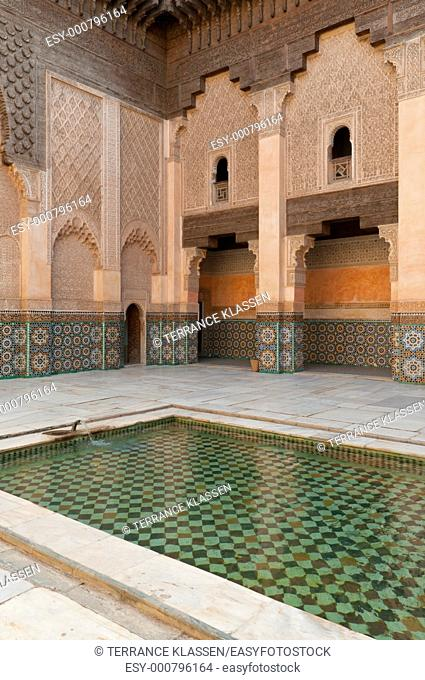The courtyard and rooms of the Medrasa Ben Youssef Quranic School and mosque in the medina, old town of Marrakesh, Morocco