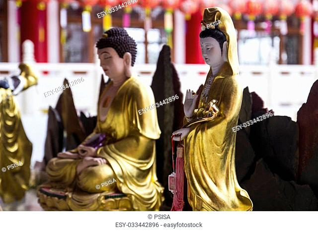 buddha and goddess of mercy statue in chinese temple