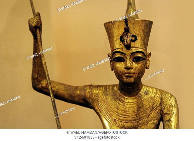 The King as harpooner, golden statue of king Tutankhamon, New Kingdom, Egyptian museum, Cairo, Egypt