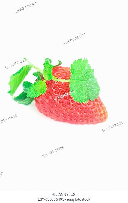 strawberry and mint isolated on white
