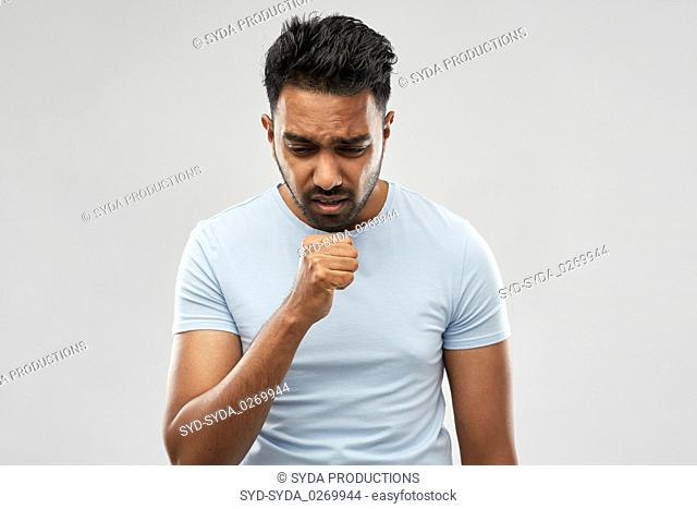 unhealthy indian man coughing