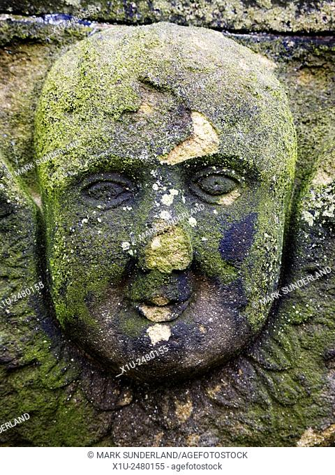 Weathered Face Carved on a Gravestone at St Michaels Church on Bailiffgate Alnwick Northumberland England