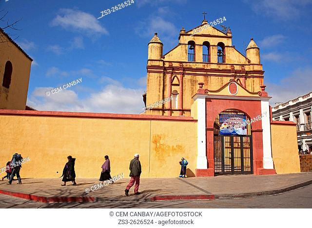 People walking in front of the Temple of St. Nicolas situated next to the Cathedral of San Cristobal, San Cristobal de las Casas, Chiapas State, Mexico