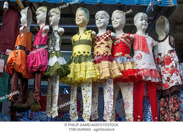 Mannequins above a children's clothing store in the predominantly Tamil town of Batticaloa, Sri Lanka