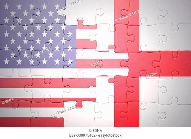 puzzle with the national flag of united states of america and england.concept
