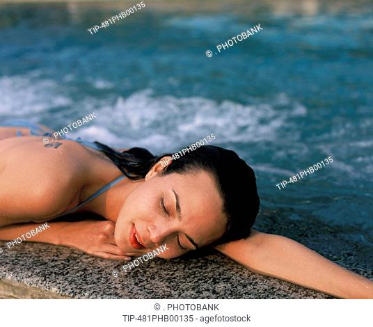 Woman lying by pool