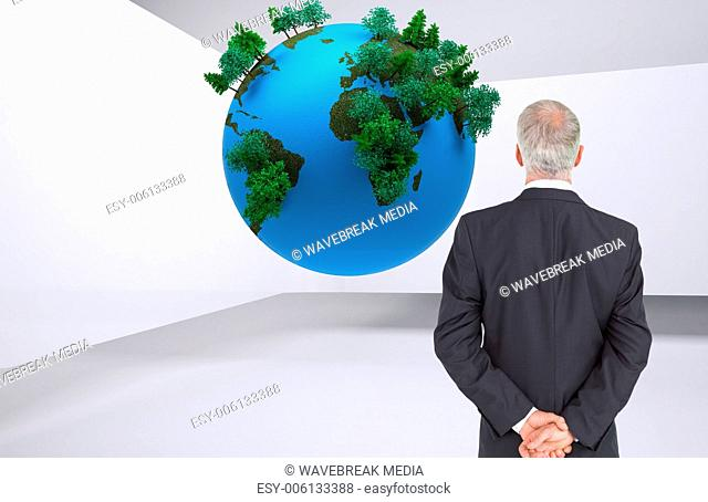 Composite image of rear view of serious businessman posing