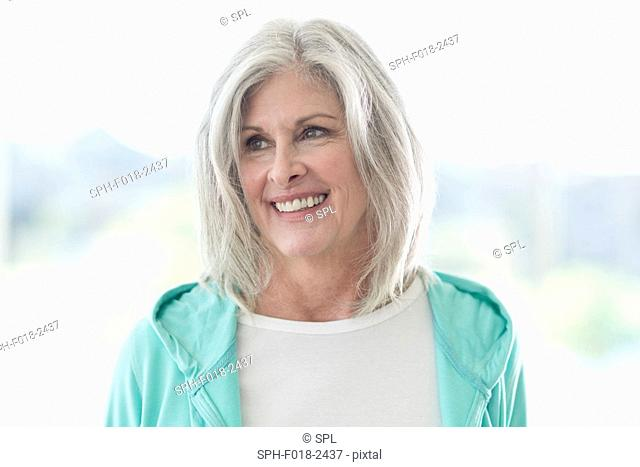 Senior woman smiling and looking away