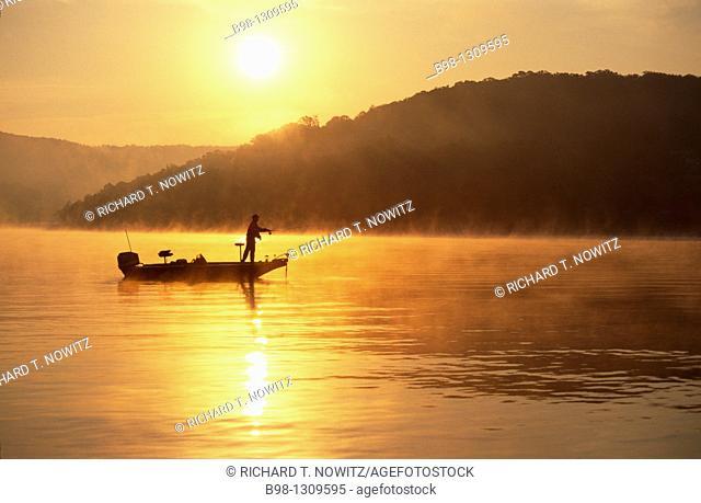 Fishing at dawn in the Table Rock lake at Big Cedar Lodge, Missouri