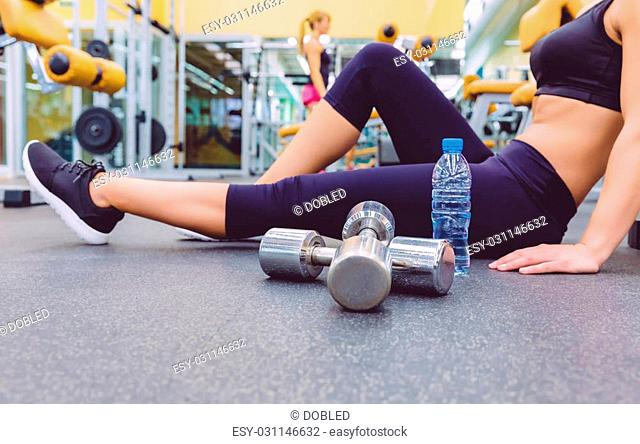 Resting floor dumbbell Stock Photos and Images | age fotostock